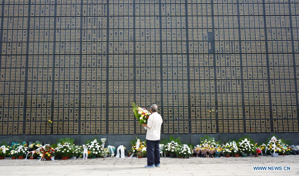 A man mourns in front of a memorial wall at the Tangshan Earthquake Memorial Park in Tangshan, north China's Hebei Province, July 28, 2021. Wednesday marks the 45th anniversary of the Tangshan earthquake. The 7.8-magnitude quake struck the city of Tangshan in Hebei Province on July 28, 1976, killing more than 240,000 people and destroying virtually all buildings. (Xinhua/Jin Haoyuan)