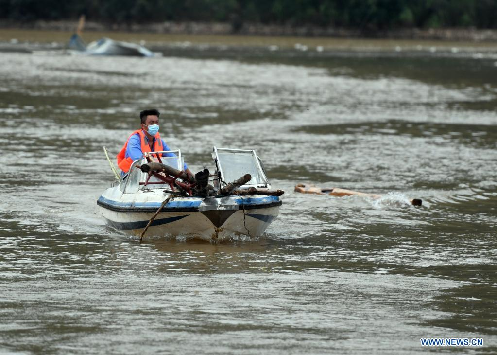A staff member clears debris from a local reservoir in flood-hit Qixian County of Hebi City, central China's Henan Province, July 28, 2021. Several parts of Qixian County are suffering from flooding caused by heavy downpour in the past few days. (Xinhua/Li Jianan)