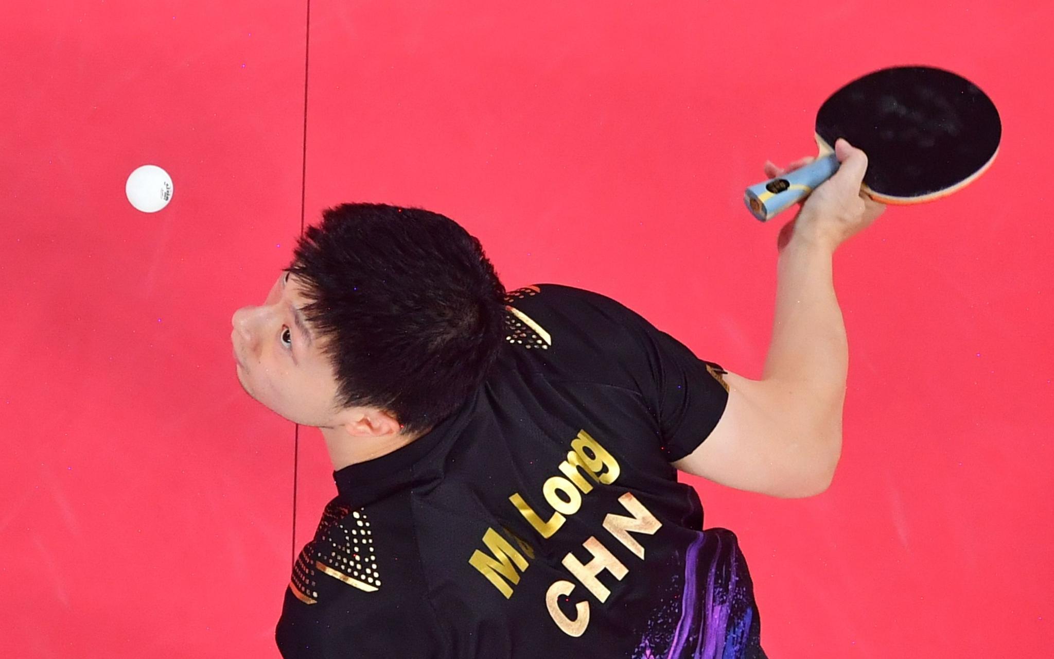 马龙成功卫冕男单金牌。图/新华社