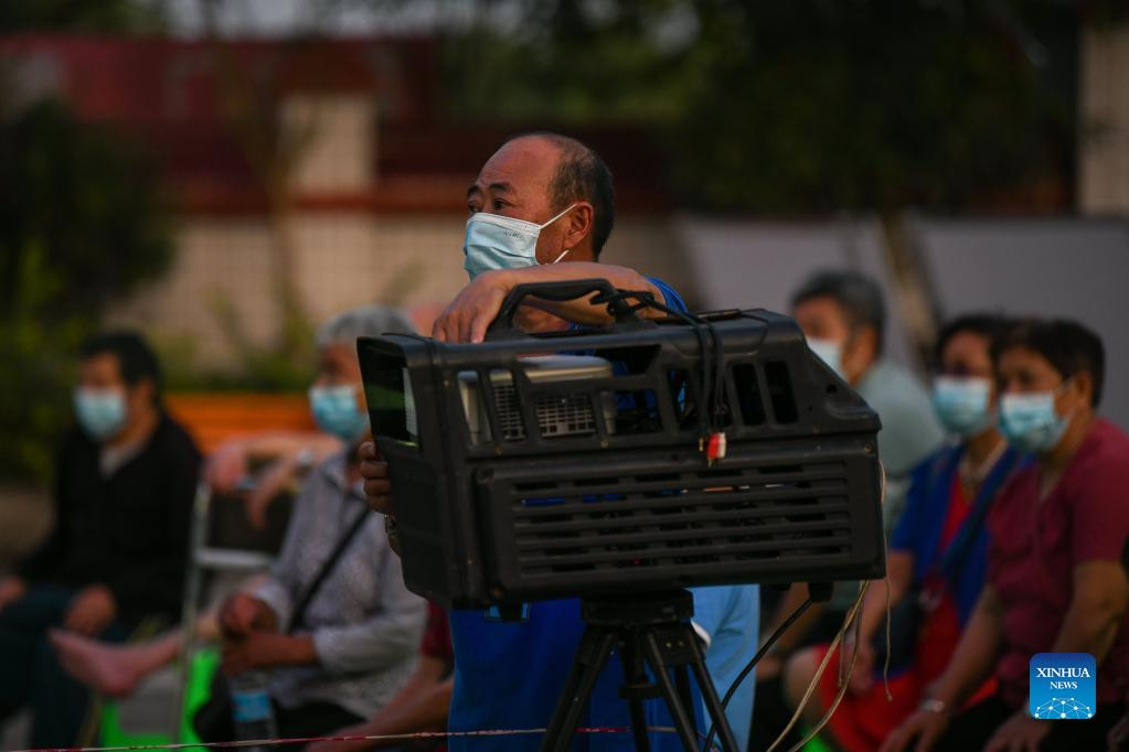 A staff member adjusts a film projector at a nursing home in Fuji Township of Luxian County, southwest China's Sichuan Province, Sept. 21, 2021. Residents from Sichuan Province who were affected by an earthquake that struck on Sept. 16 began returning home on Monday morning, as the local work priority has been shifted from emergency rescue to post-quake reconstruction. A 6.0-magnitude earthquake jolted Luxian County in the city of Luzhou at 4:33 a.m. on Sept. 16, leaving three people dead and 146 injured. (Xinhua/Xu Bingjie)