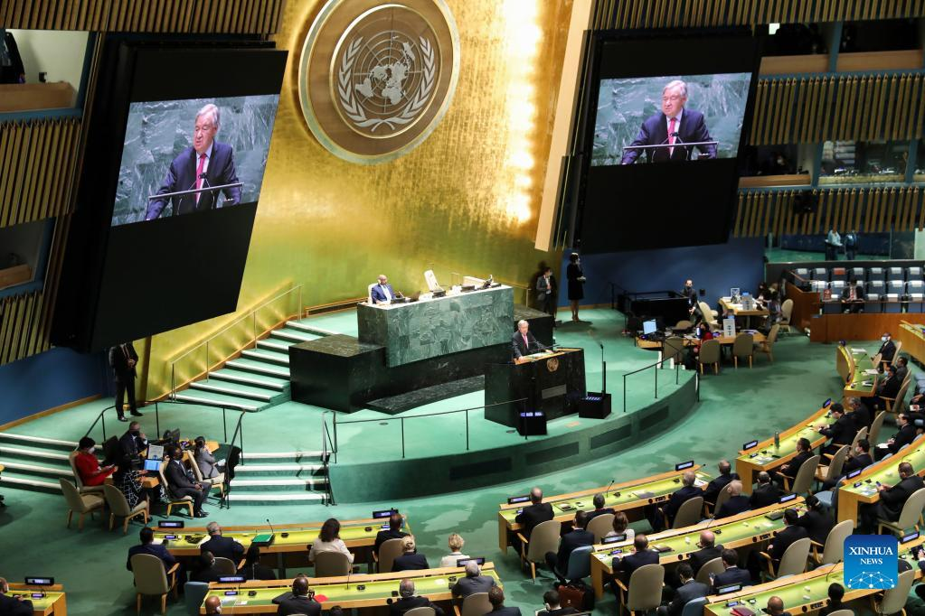 United Nations Secretary-General Antonio Guterres (at the podium and on the screens) addresses the UN General Assembly at the UN headquarters in New York, on Sept. 21, 2021. Guterres on Tuesday urged the international community to solve pressing issues as the world is in the throes of a still raging COVID-19 pandemic. (Xinhua/Wang Ying)