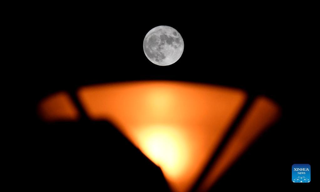A full moon is seen in Zhengzhou, central China's Henan Province, Sept. 21, 2021. (Xinhua/Zhu Xiang)