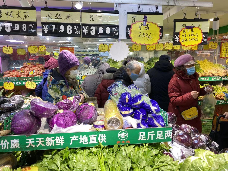 北京新发地77家便民菜店、211辆蔬菜直通车春节不停业图片