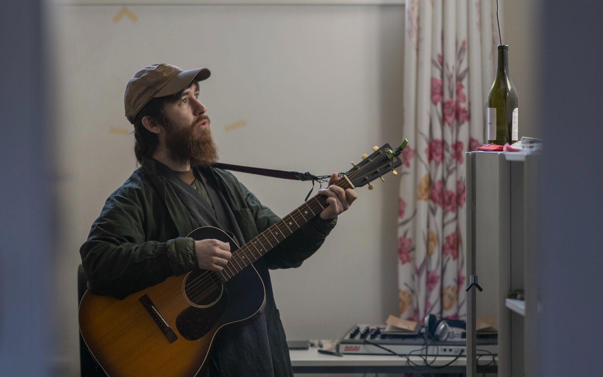 小易和他的吉他。拍照:心像SoulPix