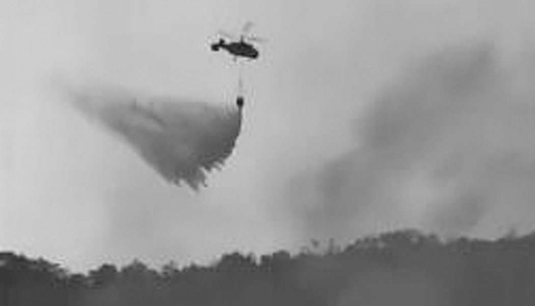 省航空护林站 派出直升机快速灭火