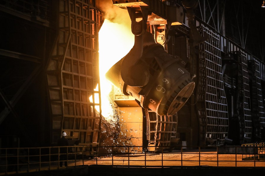 A worker checks on a furnace at a plant of Ansteel Group Co., Ltd. in Anshan, northeast China's Liaoning Province, July 5, 2019. (Xinhua/Pan Yulong)