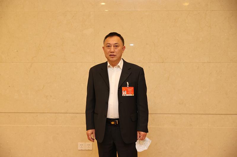 金进尧代表:企业稳定发展需要法治保障图片