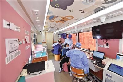 疫苗接种车亮相故宫东华门外 游客可申请接种