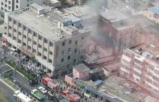 找记者上壹点|搭建的过道起火引燃住户窗户,一人轻微伤已送医治
