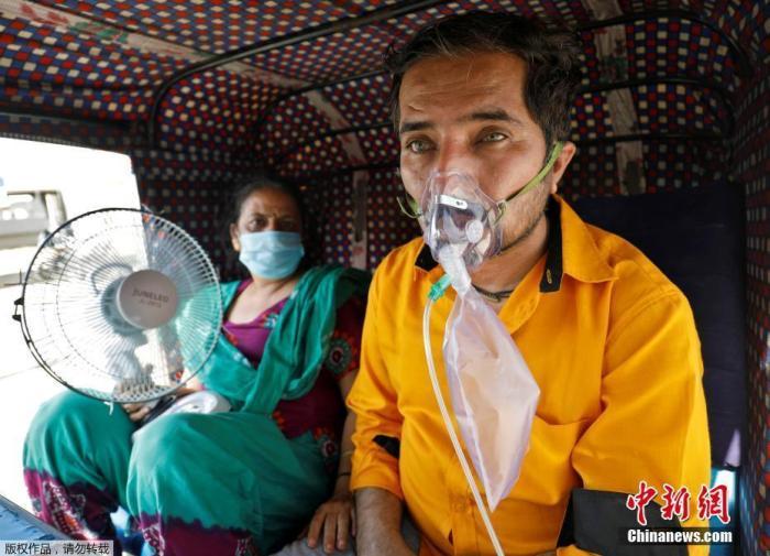 印度新冠确诊病例逼近2000万例 疫情峰值或提前