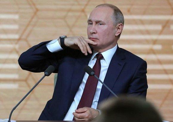 普京在记者会现场 来源:俄罗斯卫星通讯社