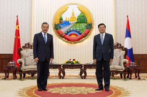 老挝总理通伦会见王毅图片