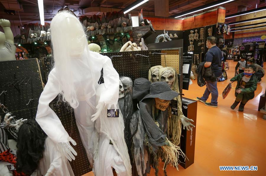 People shop for Halloween costumes in Vancouver, Canada