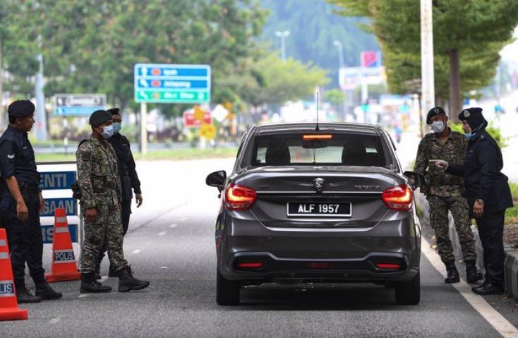 马来西亚累计确诊新冠超30万例 一天逮捕549名违法者