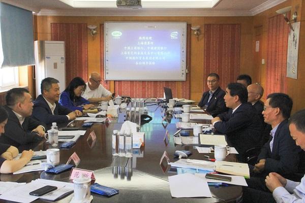 产融协同促发展 创新共进谱新篇——上海清算所监事会主席谢汉立赴上港物流开展大宗商品业务调研