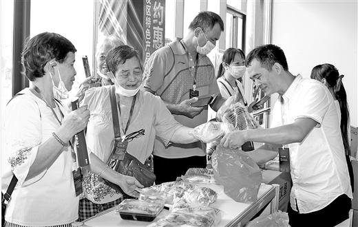 广西壮族自治区人民政府门户网站广西-东盟经开区特色产品展销会开幕图片