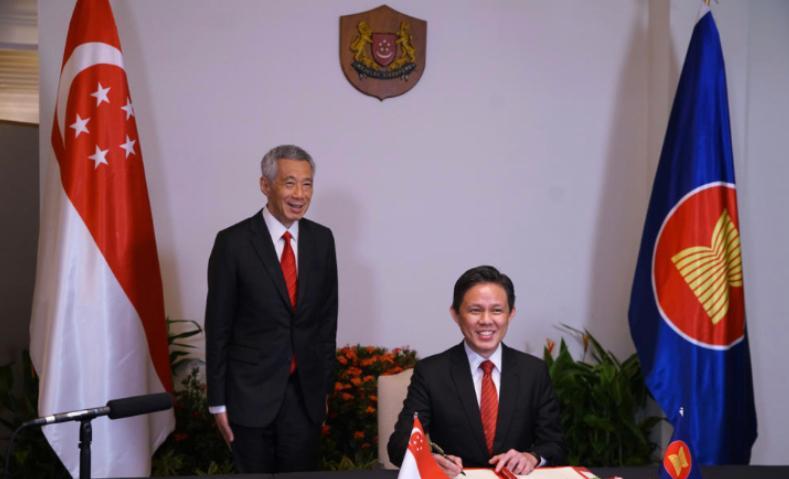 新加坡总理李显龙:签署RCEP是促进世界经济迈出的重要一步图片