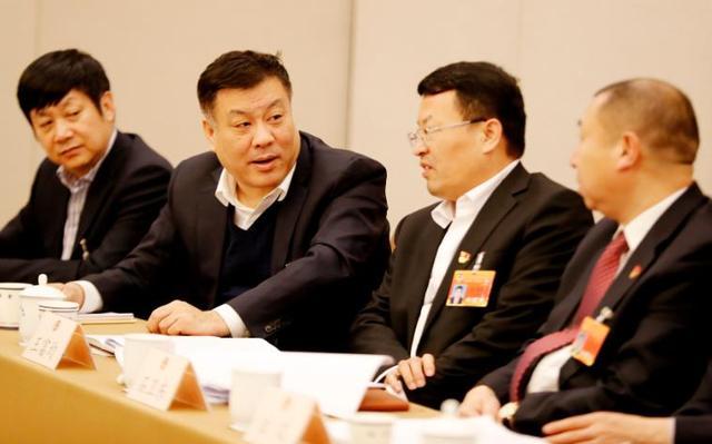 北京市政协委员分组讨论政府工作报告:深受鼓舞图片