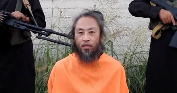 遭恐怖组织绑架时的安田(朝日新闻社)