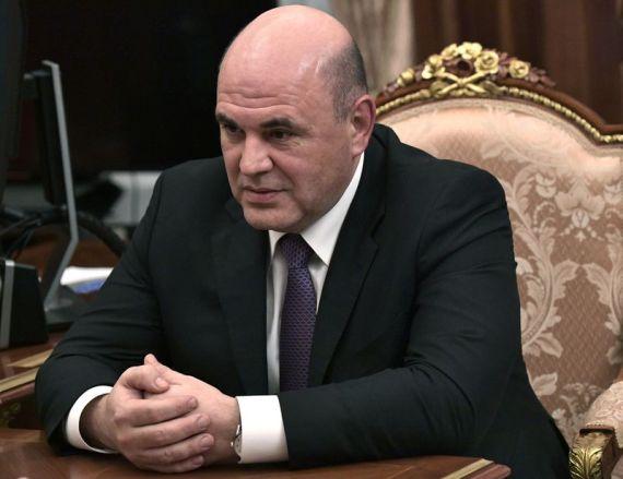 1月15日在俄罗斯莫斯科拍摄的与俄罗斯总统普京进行工作会谈中的米舒斯京。 新华社 图