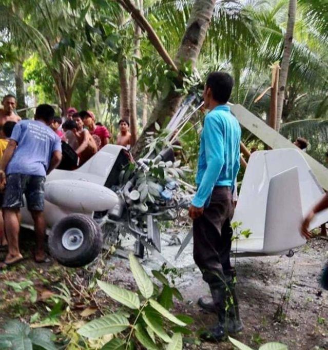 菲律宾发生坠机事件致一死 或因操作不当勾到椰子树