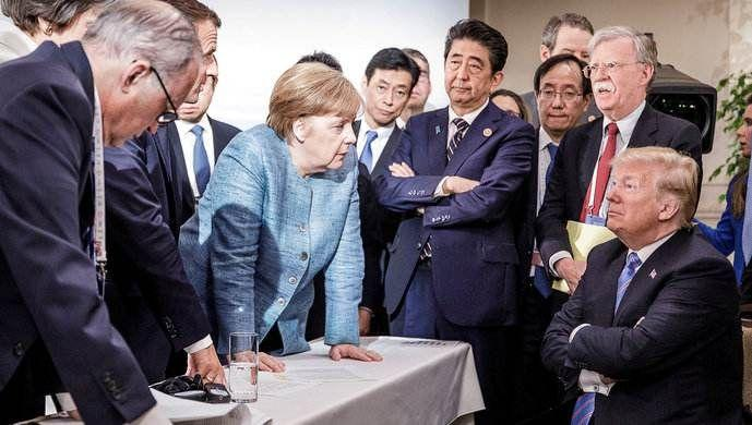 """2018年6月,七国集团(G7)峰会上,默克尔与特朗普""""交锋"""""""