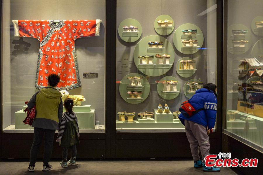 <p>People visit a photo at the exhibition of