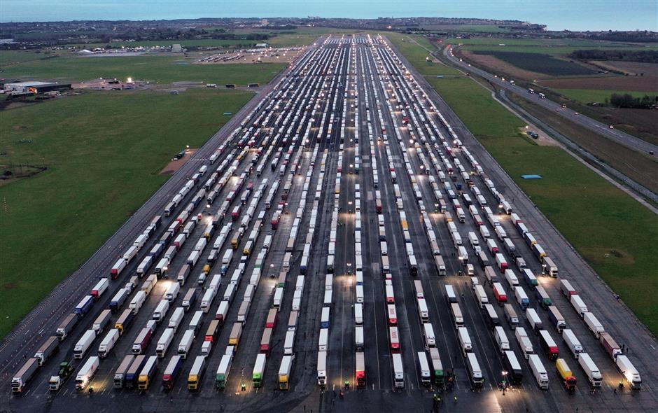 UK reaches deal with France to allow trucks to cross border from Wednesday
