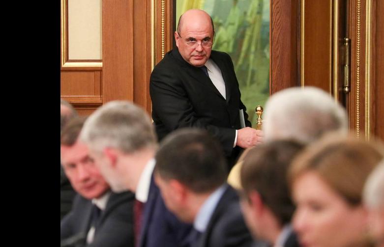 ▲ 1月22日,俄罗斯总理米舒斯京(中)参加新一届内阁会议。| 塔斯社