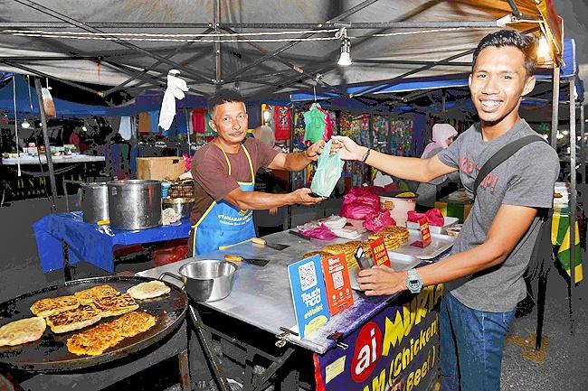 马来西亚大力推广电子支付 促进中小企业发展