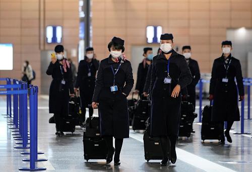 外媒:世卫组织指新冠肺炎仅是多发性传染病 航班做好防护可以飞