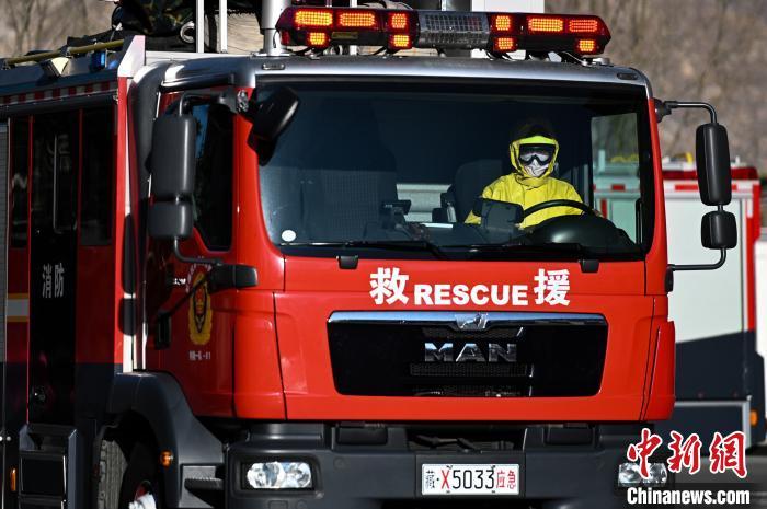西藏消防救援总队开展疫情防控期灾害事故应急处置演练图片