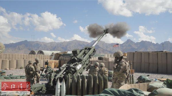 资料图片:阿富汗战争给美国带来沉重负担,图为驻阿美军向敌方目标开火。(美国陆军网站)