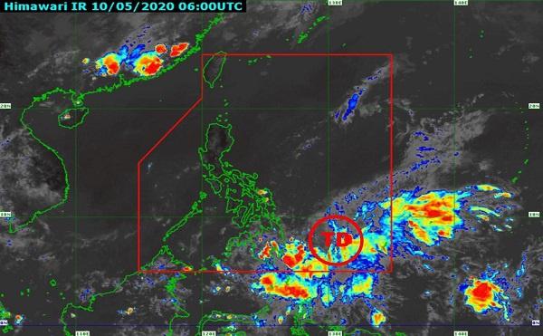 △菲律宾国家气象局10日14时发布的卫星云图,红圈TD表示热带低压