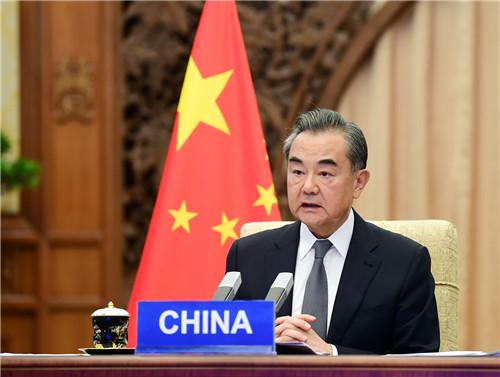 外交部长在中俄印外长视摩天登录频会晤上,摩天登录图片