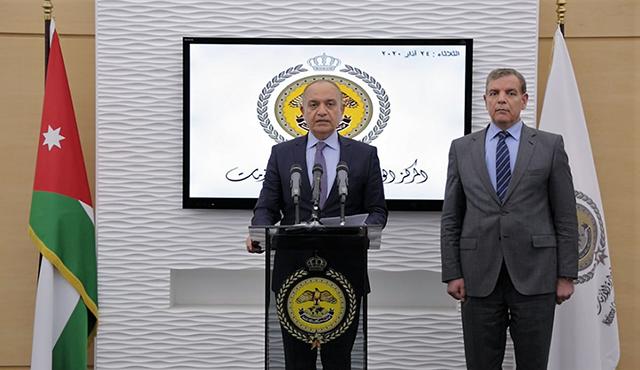 △约旦新闻事务国务大臣阿姆贾德·阿达亚拉(左)与约旦卫生大臣萨阿德·贾比尔(右)