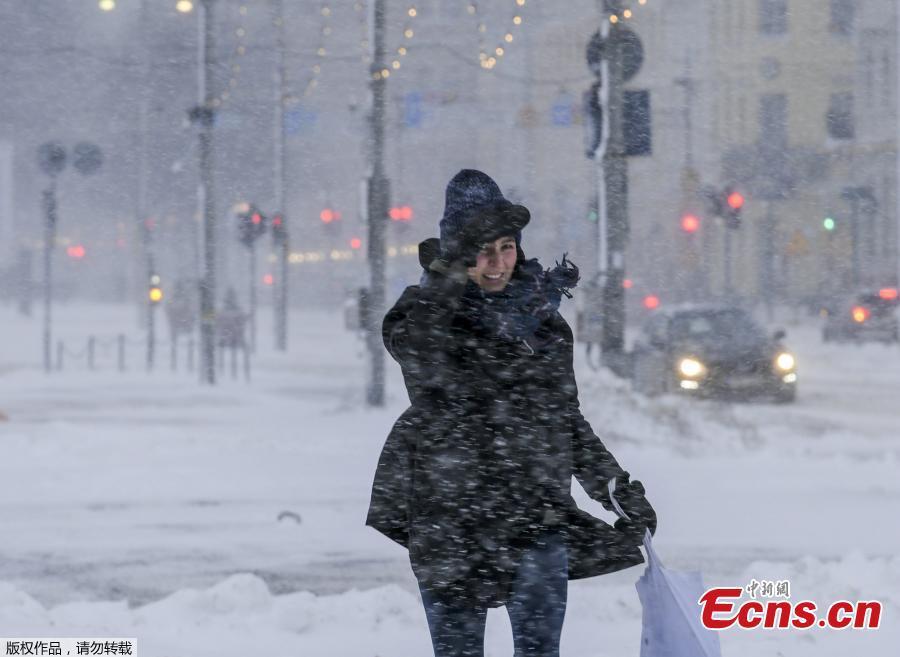 <p>A woman walks on a snow-covered street amid heavy snowfall in Helsinki, Finland, Jan. 12, 2021. (Photo/Agencies)</p>