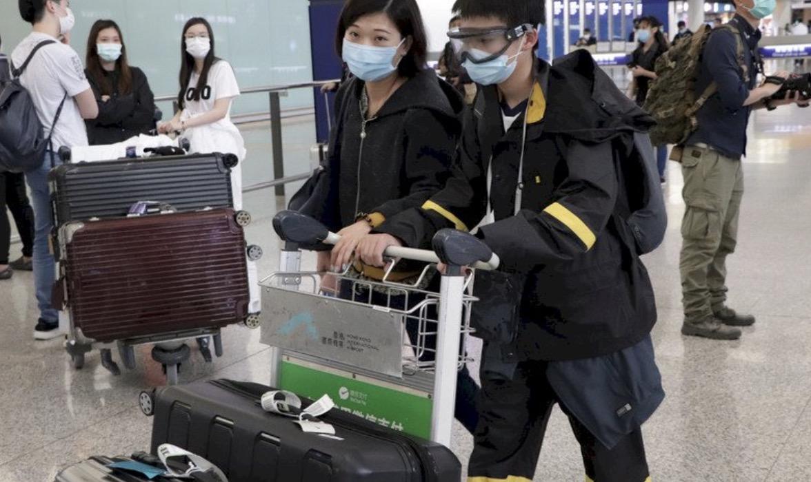 20日起赴香港获豁免检疫人士须在机场等候检测结果图片