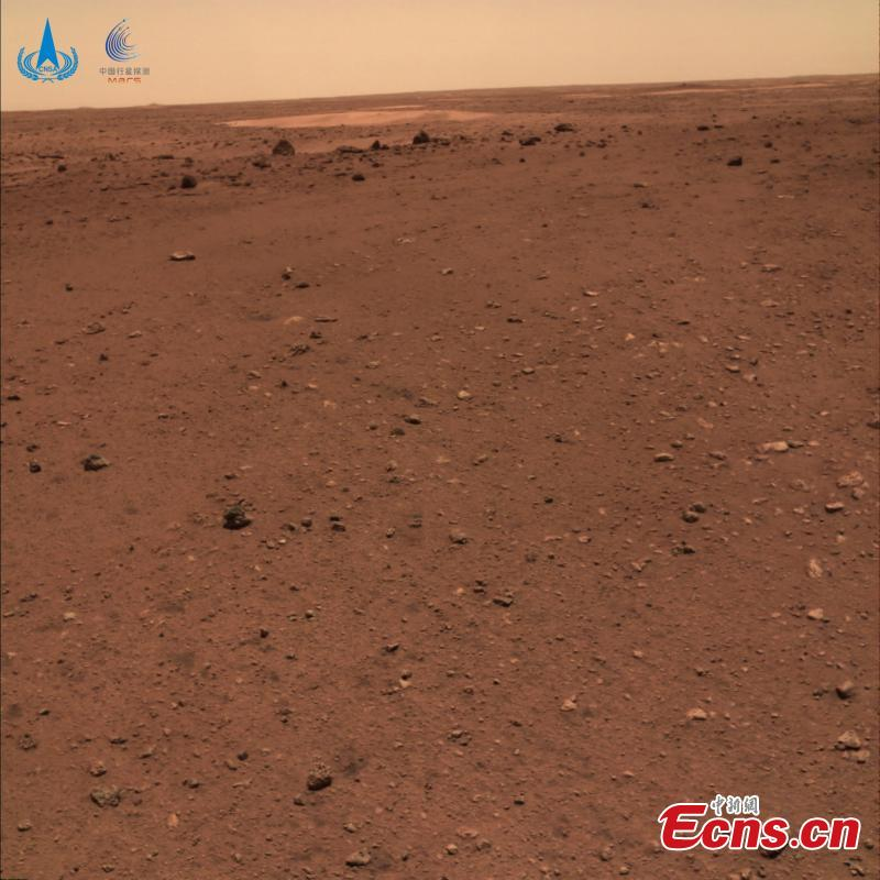<p>The China National Space Administration Friday released new images taken by the country's first Mars rover Zhurong, showing national flag on the red planet. The images were unveiled at a ceremony in Beijing, signifying a complete success of China's first mars exploration mission. The images include the landing site panorama, Martian landscape and a selfie of the rover with the landing platform.</p>