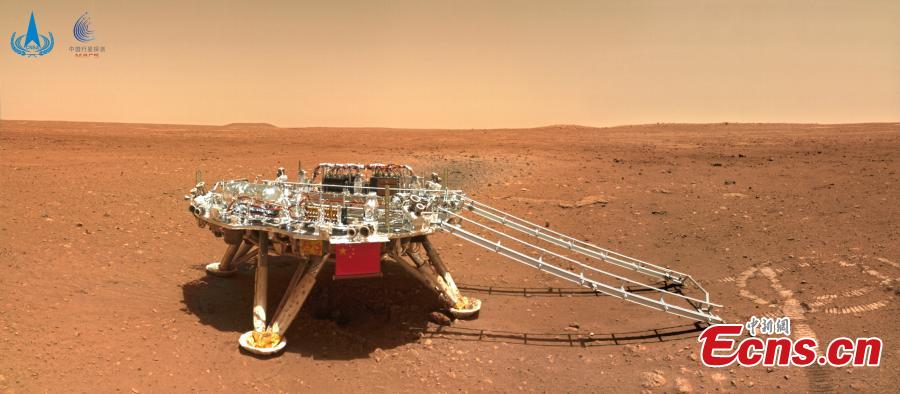 <p>Photo released on June 11, 2021 by the China National Space Administration (CNSA) shows a selfie of China's first Mars rover Zhurong with the landing platform. (Photo/CNSA)  </p>