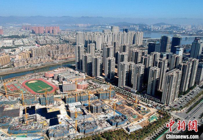 资料图:航拍一处新建住宅。中新社记者 吕明 摄
