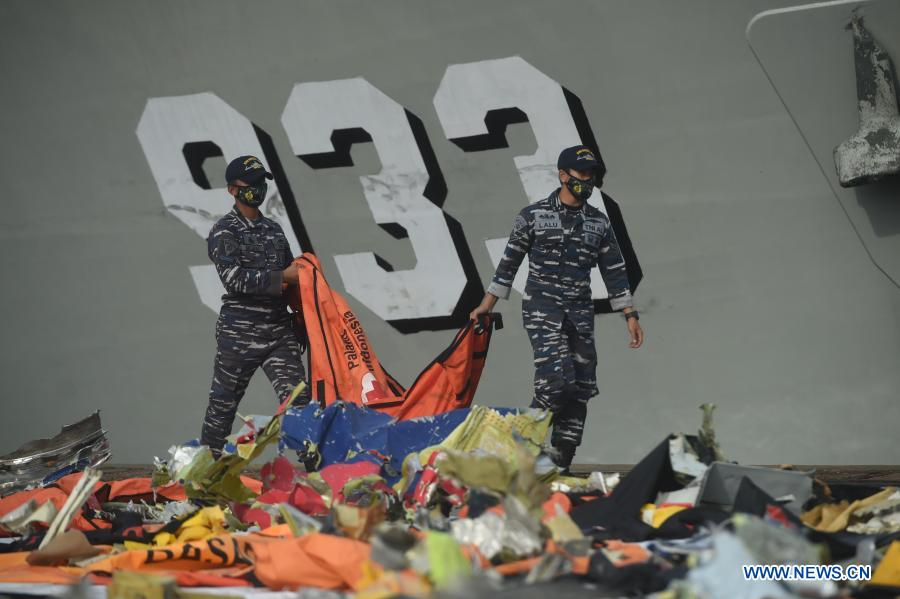 Indonesian rescue team inspects debris of Sriwijaya Air flight SJ-182 at Tanjung Priok port