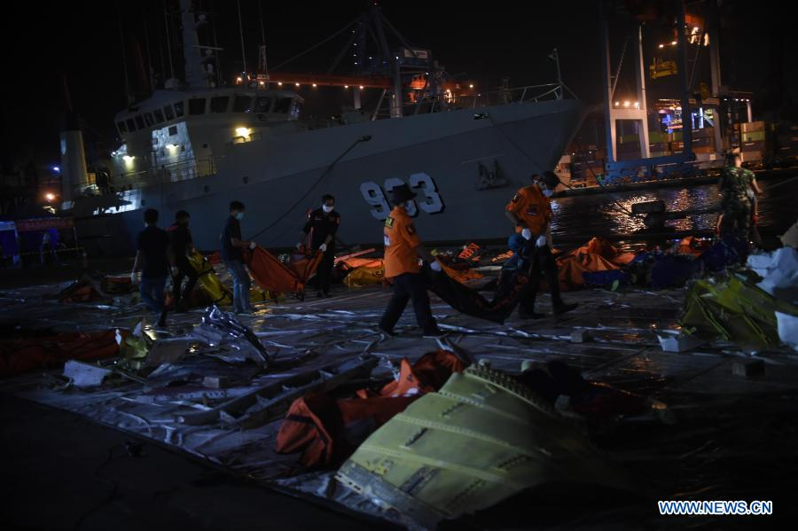 Staff members load wreckage from crashed Sriwijaya Air flight SJ-182 for investigation in Jakarta