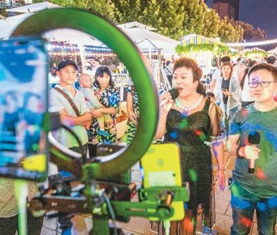 人民日报海外版:你喜欢在线K歌吗?