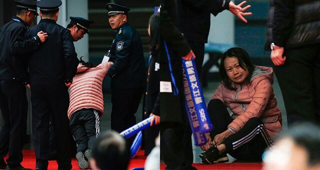 女子大闹球场被安保人员抬离