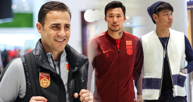 国足中国杯后返回广州 卡纳瓦罗面带微笑
