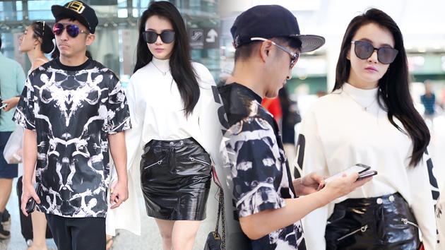 拳王邹市明携美妻冉莹颖机场时尚秀
