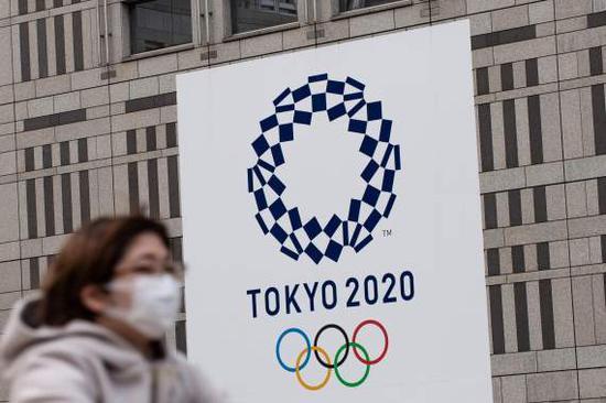 """日本奥运大臣:应该""""不惜一切代价""""举办奥运会"""