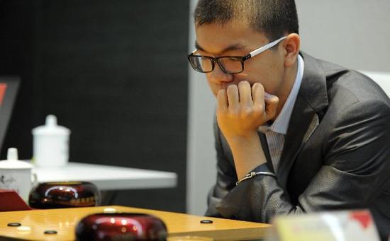 2014年,柯洁在百灵杯世界围棋公开赛中。新华社记者陶亮摄