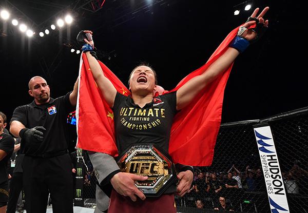 张伟丽成为UFC新hg0088官网世界冠军。本文图片 视觉中国、IC